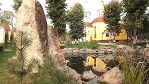 small pond in a park near the church decorative pond ornamental