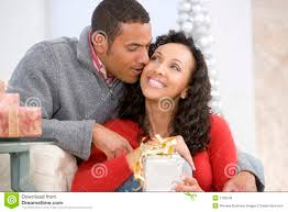 husband and wife exchanging christmas gifts royalty free stock