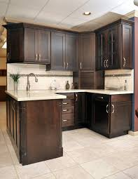 espresso kitchen cabinets with white quartz countertops oak is out quartz is in lifestyle lancasteronline