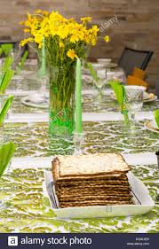 modern seder matzos on a modern passover seder table with green and gold stock
