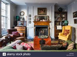 red chinese chest in living room with khotan rug from turkestan