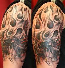 attractive flaming skull on right shoulder