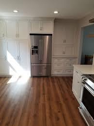 oak kitchen cabinets with oak flooring farmhouse kitchen coretec pro plus monterey oak vinyl