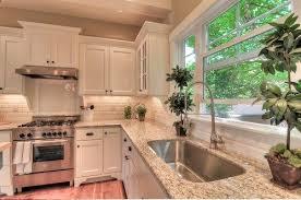 white kitchen with giallo ornamental also known as amarello