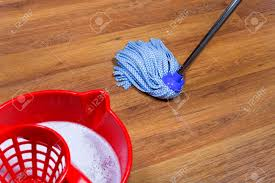 with water and mopping of laminate floors stock photo