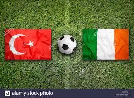 turkey vs ireland flags on green soccer field stock photo