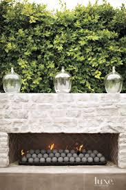 contemporary rectilinear outdoor fireplace luxe outdoors