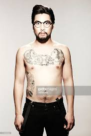 young male model with tattoo and glasses stock photo getty images