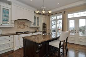 kitchen with island and breakfast bar kitchen island chairs spacious modern kitchen with cabinetry