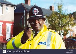 community police officer on the beat talking into his walkie
