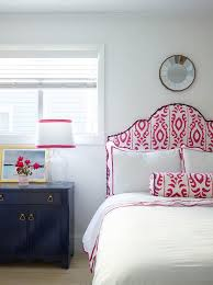 pink ikat headboard with blue nightstand transitional bedroom