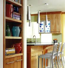 blooming cherry color kitchen cabinets with bar stool pendant