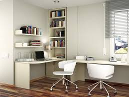 study table l white wooden desk and white wooden shelves on white wall plus