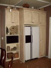 dream kitchen cabinets built to house the fridge where the freezer used to be the shelves above and below the microwave are adjustable as are all the shelves in the