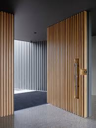 Wood Slat by These 13 Sophisticated Modern Wood Door Designs Add A Warm Welcome
