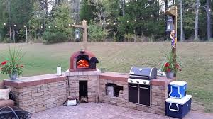 outdoor kitchen with wood fired pizza oven u0026 gas grill rustic