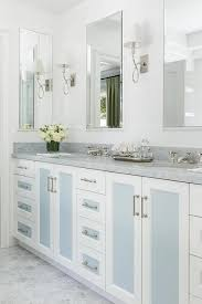 white and blue washstand cabinet doors transitional bathroom