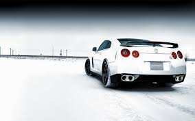 white nissan white nissan car on the road full with snow