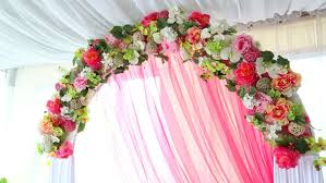 wedding archway with flowers arranged in park for a wedding