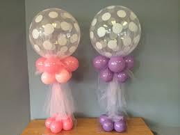 polka dot tulle covered balloon centerpiece is air filled
