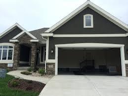 dark grey stucco exterior white trim nice stone entrance maba