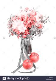 drama black and white bouquet in a vase with red apple isolated on