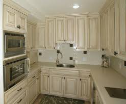 timeless kitchen design white marble floor wall mounted cabinets