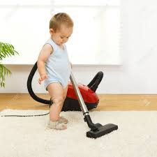Baby Carpet Baby Boy Cleaning The Carpet With Vacuum Cleaner Stock Photo