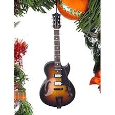 acoustic guitar with notes tree