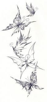 flying butterflies tattoos on upperback