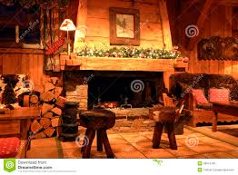 traditional chalet living room with a wood burning fireplace stock