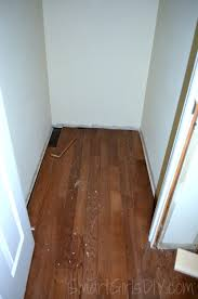 T Shaped Transition Strip by Upstairs Hallway 1 Installing Hardwood Floors