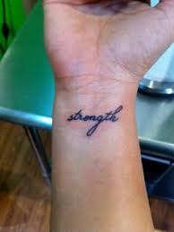 create brown ink wrist tattoo blu gorilla tattoos charleston