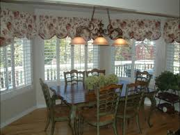 dining room valance plantation shutters with a fabric valance in a dining room