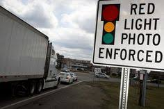 city of chicago red light cameras a sign warns motorists of the presence of a red light camera in
