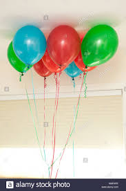 balloons that float green and blue bunch of balloons float inside stock photo