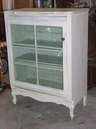dresser turned into curio cabinet the door is an old window