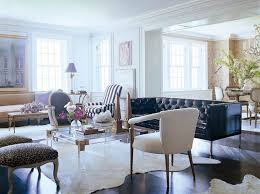 cowhide rug living room ideas sophisticated white cowhide rug with black leather tufted