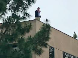 darrell issa stands on office roof above protestors business insider