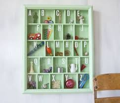 Alphabet Bookcase 20 Pieces Of Alphabet Art For Your Baby U0027s Nursery Brit Co