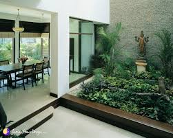 wooden staircase and courtyard design by kumar moorthy and