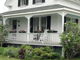 new houses being built with classic new england style detail porch of classic white new england house on mount desert