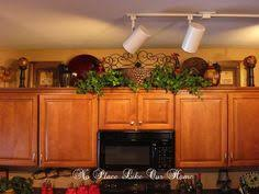 Top Of Kitchen Cabinet Decor by Decor On Top On Kitchen Cabinets Grapes Vines And Porcelain Pots