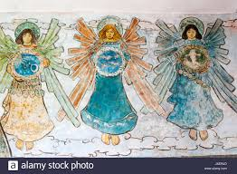 detail of 19th century painted frieze of angels from the church of