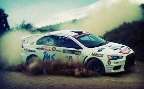 mitsubishi rally car 798431 cars depth of field dirt drifting dust mitsubishi lancer