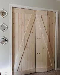 Thin Closet Doors Create A Beautiful Reclaimed Wood Barn Door From An Bifold