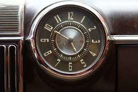 foap com old style art deco clock on vintage cadillac dashboard