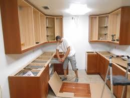 putting up kitchen cabinets installing base cabinets install your own cabinets how to put up