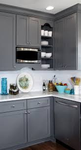 best transitional kitchen ideas pinterest gray and white transitional kitchen design with teal blue yellow accents featuring painted cabinetry