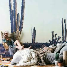 removable fabric wall murals printed to order by australia s the cactus mural in front of a lady sitting on a chair